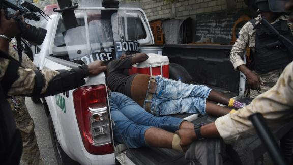Haitian police arrest demonstrators during clashes in Port-au-Prince on Tuesday.