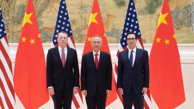 Chinese Vice Premier Liu He standing between US Trade Representative Robert Lighthizer  and US Treasury Secretary Steven Mnuchin at the start of two days of high-level trade talks in Beijing on Thursday.