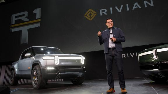 RJ Scaringe, founder and chief executive officer of Rivian Automotive Inc., unveils the R1T electric pickup truck and R1S electric SUV in Los Angeles.