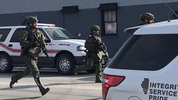The scene in Aurora, photographed by Beacon News crime reporter Megan Jones, of the on-going possible active shooter. Dozens of area police officers have responded to the situation, and there are many injuries, according to Kendall County Dispatch.