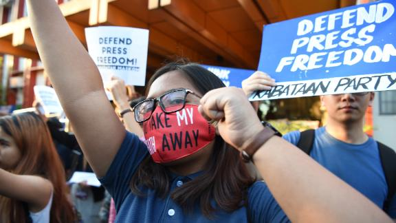 Students hold placards as they shout slogans during a protest at the state university grounds in Manila on February 14, 2019, in support of CEO of Rappler, Maria Ressa, who was arrested a day earlier for cyber libel case. - Ressa was freed on bail on February 14 following an arrest that sparked international censure and allegations she is being targeted over her news site's criticism of President Rodrigo Duterte. (Photo by TED ALJIBE / AFP)        (Photo credit should read TED ALJIBE/AFP/Getty Images)