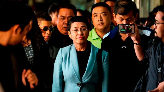 Philippine journalist Maria Ressa (C) arrives at a regional trial court in Manila to post bail on February 14, 2019. - Ressa was freed on bail on February 14 following an arrest that sparked international censure and allegations she is being targeted over her news site