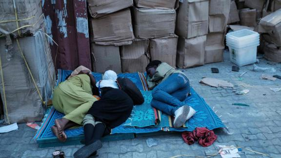 Staff of the Independent National Electoral Commission (INEC) sleep on a ground beside electoral items at a local office in Port Harcourt, Southern Nigeria on February 16, 2019 after Nigeria