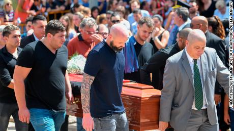 Nantes player Nicolas Pallois (C) carries Emiliano Sala's coffin together with Sala's brother Dario.