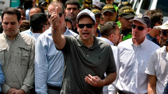 US senator Marco Rubio (C) gestures as he walks at the Simon Bolivar international bridge in Cucuta, Colombia, border with San Antonio de Tachira, Venezuela on February 17, 2019.