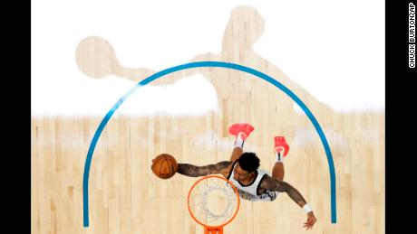 Atlanta Hawks John Collins dunks the ball during the NBA All-Star Slam Dunk contest, Saturday, February 16, 2019, in Charlotte, North Carolina.
