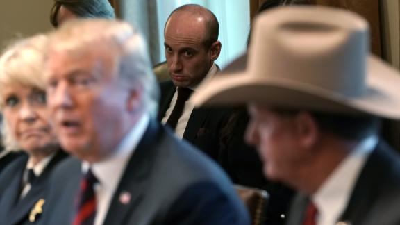 WASHINGTON, DC - JANUARY 11:  Senior Advisor to the President Stephen Miller (C) looks on as U.S. President Donald Trump hosts a round-table discussion on border security and safe communities with State, local, and community leaders in the Cabinet Room of the White House on January 11, 2019 in Washington, DC. As the second-longest government shut down continues, Democrats and Republicans have not found a compromise for border security funding and President Donald Trump