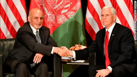 US Vice President Mike Pence (R) shakes hands with Afghanistan's President Mohammad Ashraf Ghani during their bitaleral talks at the 55th Munich Security Conference (MSC) in Munich, southern Germany, on February 16, 2019. - The 2019 edition of the Munich Security Conference (MSC) takes place from February 15 to 17, 2019. (Photo by THOMAS KIENZLE / AFP)        (Photo credit should read THOMAS KIENZLE/AFP/Getty Images)