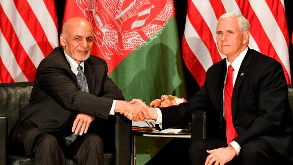 US Vice President Mike Pence (R) shakes hands with Afghanistan