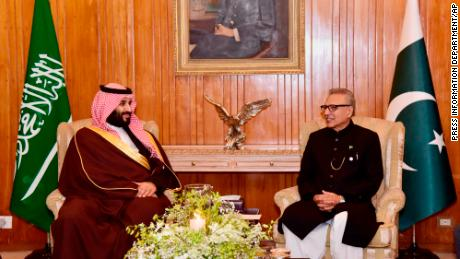 Bin Salman (left) met with Pakistani President Arif Alvi in Islamabad on February 18.
