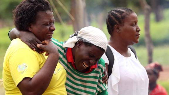 Women console a mourner as relatives arrive to await news on the return of the body of one of the miners.
