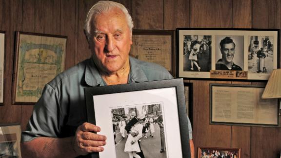 George Mendonsa, 89, holds one of the most iconic photographs of the 20th century at his Middletown, Rhode Island home, October 2,3 2012. In the photograph, Mendonsa is widely believed to be the sailor kissing an unsuspecting nurse (actually a dental hygienist) on V-E Day in Times Square in 1945. The photograph was taken by Life Magazine photographer Alfred Eisenstaedt. (Patrick Raycraft/Hartford Courant/MCT via Getty Images)
