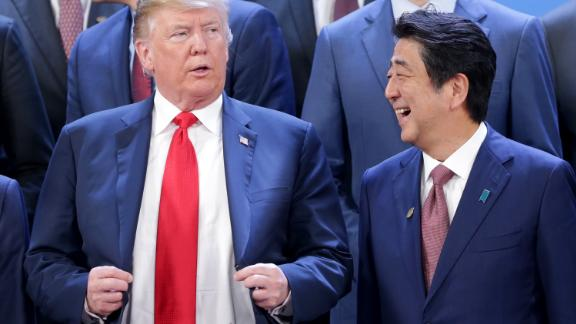 BUENOS AIRES, ARGENTINA - NOVEMBER 30: (L-R) President of  U.S. President Donald Trump and Prime Minister of Japan Shinzo Abe talk during the family photo opening day of Argentina G20 Leaders