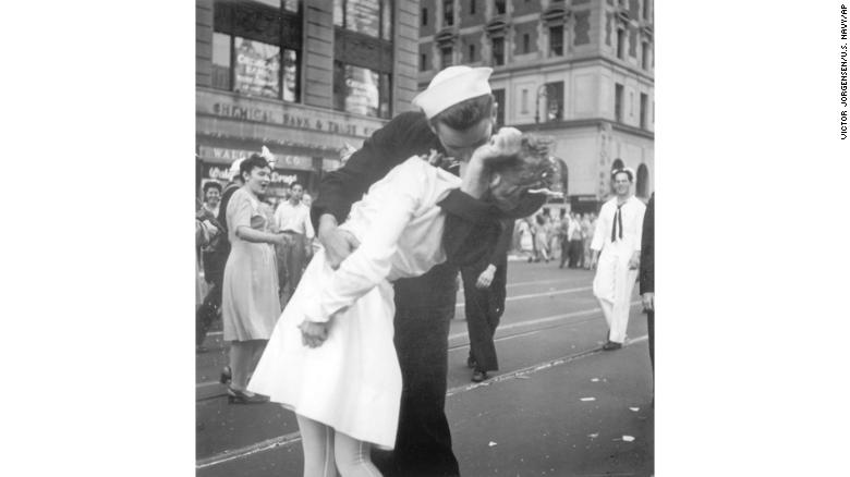 On August 14, 1945, a sailor kisses an unsuspecting woman in New York's Times Square.