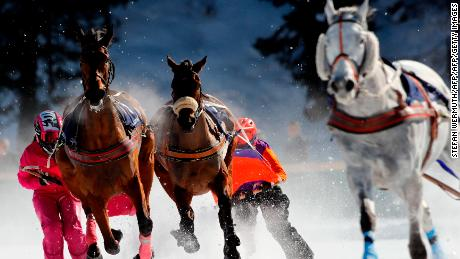 Competitors take part in the Skikjoering race at the White Turf horse racing event held on the frozen lake of the Swiss mountain resort of St. Moritz on February 17, 2019. - More images can be found on www.afpforum.com. Search slug: HORSE-RACING-SWITZERLAND (Photo by STEFAN WERMUTH / AFP)        (Photo credit should read STEFAN WERMUTH/AFP/Getty Images)