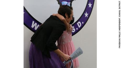 Prisilla hugged her teacher.