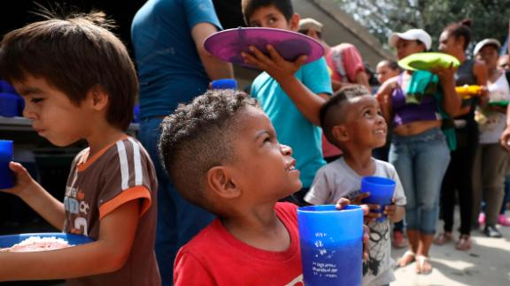 """Venezuelan boys enjoy the free lunch that is given out daily at the """"Divina Providencia"""" migrant shelter in La Parada, near Cucuta, Colombia, on the border with Venezuela."""
