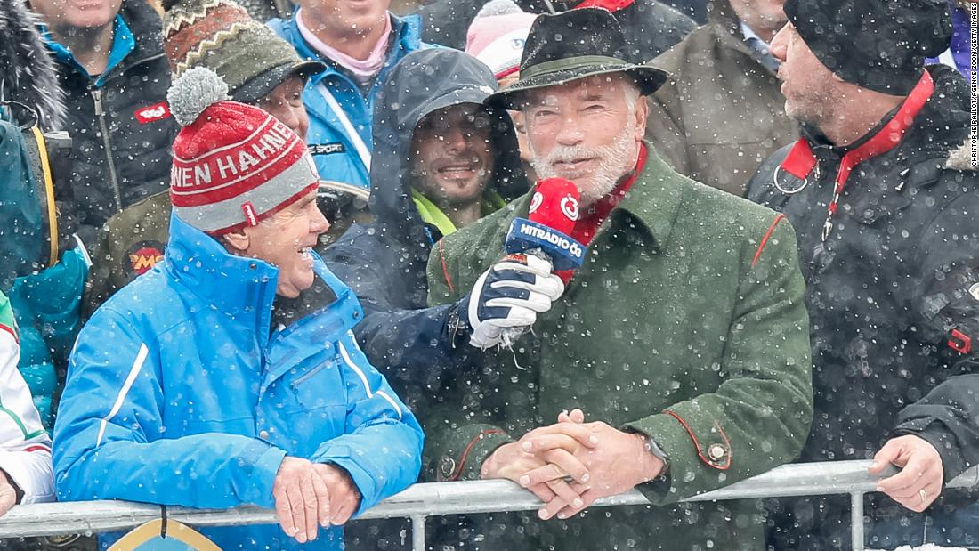 """He's back...!"" Muscleman, movie star and politician Arnold Schwarzenegger takes in the action during his regular visit to the Hahnenkamm races in Kitzbuhel."
