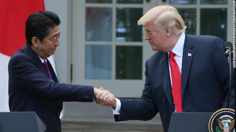 US President Donald Trump (R) and Japanese Prime Minister Shinzo Abe shake hands at the White House, on June 7, 2018 in Washington, DC.