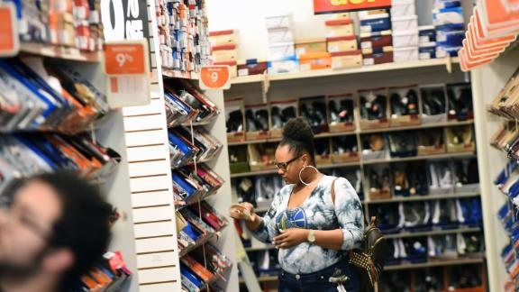A woman shops at a Payless ShoeSource store in Orlando, Florida on February 17, 2019, the first day of the firm's liquidation sale after confirming on February 15, 2019 that it will close its 2,100 stores in the U.S. and Puerto Rico.