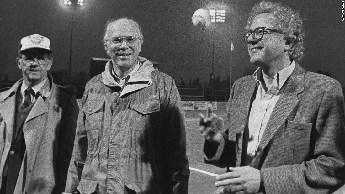 Sanders, right, tosses a baseball before a minor-league game in Vermont in 1984. US Sen. Patrick Leahy, center, was also on hand.
