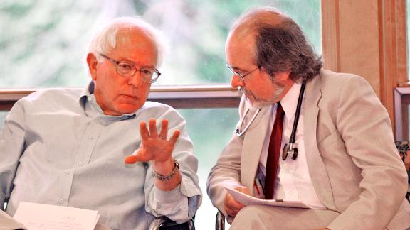 Sanders chats with Dr. John Matthew, director of The Health Center in Plainfield, Vermont, in May 2007. Sanders was in Plainfield to celebrate a new source of federal funding for The Health Center.