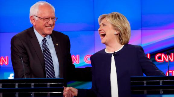 "Sanders shakes hands with Hillary Clinton at a Democratic debate in Las Vegas in October 2015. The hand shake came after Sanders' take on the Clinton email scandal. ""Let me say something that may not be great politics, but the secretary is right -- and that is that the American people are sick and tired of hearing about the damn emails,"" Sanders said. ""Enough of the emails, let's talk about the real issues facing the United States of America."""