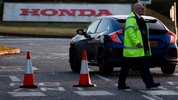 A man walks past the entrance of the Honda plant in Swindon on Tuesday.