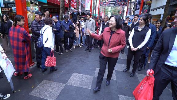 Tsai meets with her constituents on a street in the capital Taipei on February 18.
