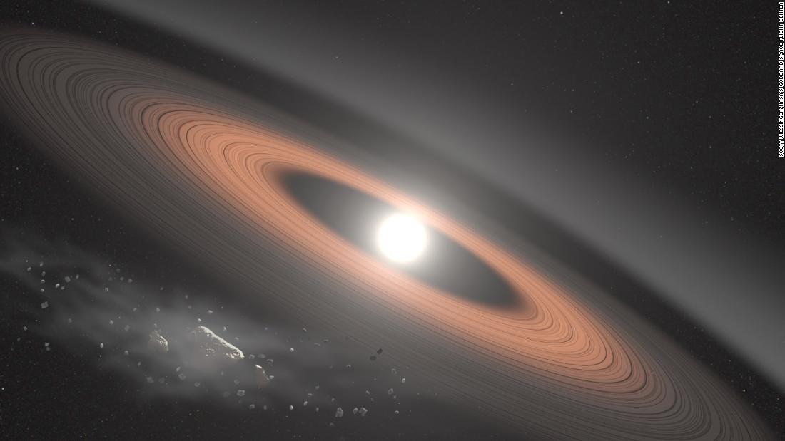 In this illustration, an asteroid (bottom left) breaks apart under the powerful gravity of LSPM J0207+3331, the oldest, coldest white dwarf known to be surrounded by a ring of dusty debris. Scientists think the system's infrared signal is best explained by two distinct rings composed of dust supplied by crumbling asteroids.