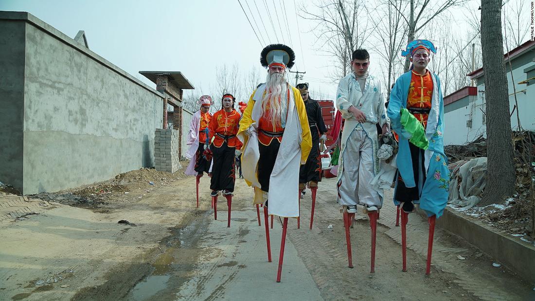 China's street-dancing stilt walkers risk safety in exchange for thrills
