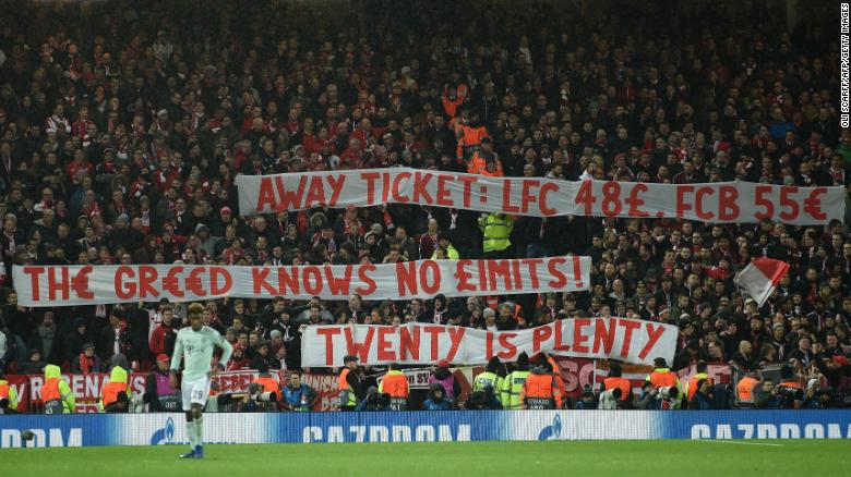 Bayern fans display placards complaining about ticket prices during the Champions League round of 16, first leg between Liverpool and Bayern Munich at Anfield on February 19, 2019.