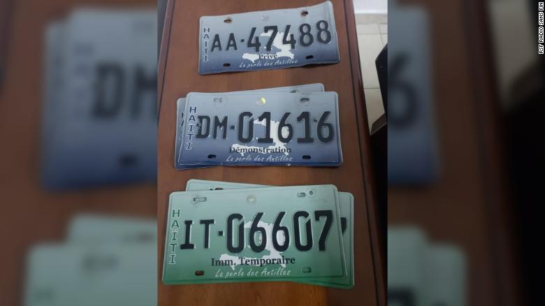 The detainees were allegedly found in posession of multiple license plates.