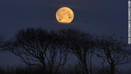 The final supermoon of the year occurs as an asteroid zips close by