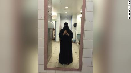 This photo was taken in a restroom in an airport during a trip to Turkey. The sisters wore this type of niqab when they were traveling outside Saudi Arabia.