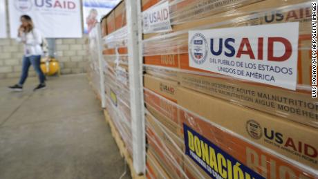 Boxes of aid ready for distribution sit inside a warehouse at the Tienditas International Bridge in Cucuta, Colombia, on Tuesday