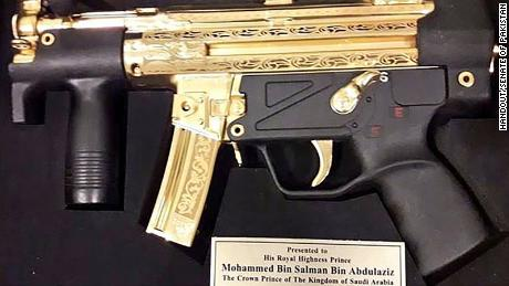 Pakistani senators gave bin Salman this gold-plated gun.
