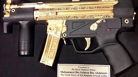 Pakistani senators gave bin Salman this gold-plated gun.