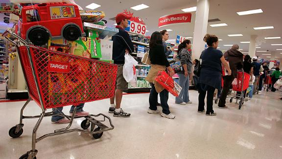 Shoppers crowd into the Target store in the Lakewood Center mall early Friday morning, November 24, 2006.