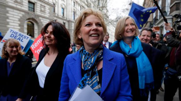 British politicians Anna Soubry, center, Heidi Allen, second left, and Sarah Wollaston, right, arrive for a press conference in Westminster in London, Wednesday, Feb. 20, 2019. Cracks in Britain's political party system yawned wider Wednesday, as three pro-European lawmakers - Soubry, Allen and Wollaston - quit the governing Conservatives to join a newly formed centrist group of independents who are opposed to the government's plan for Britain's departure from the European Union. (AP Photo/Kirsty Wigglesworth)