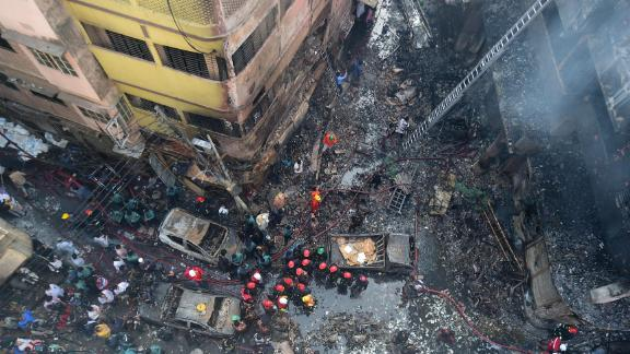 Firefighters are seen at the scene of a fire in Dhaka on February 21, 2019.