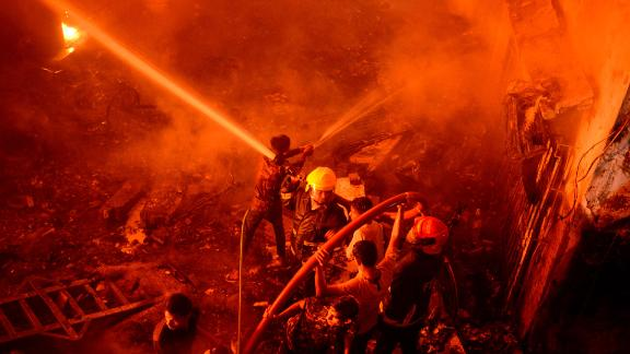 Firefighters try to douse flames in Dhaka, Bangladesh on February 20, 2019.