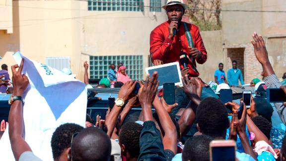 Ousmane Sonko delivering a speech to supporters.