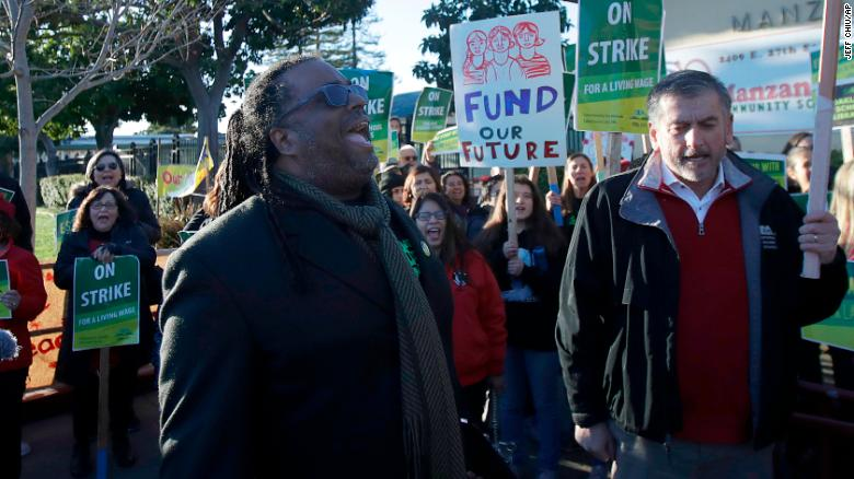 Teachers' union president Keith Brown yells after speaking outside of a school in Oakland on February 21.