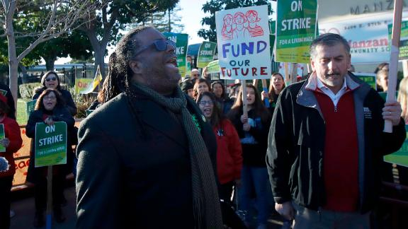 Oakland Education Association President Keith Brown yells with teachers as they strike for higher pay.