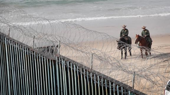 TIJUANA, MEXICO - JANUARY 28: U.S. border patrol agents stand watch across the border where the border wall that separates the U.S. and Mexico meets the Pacific Ocean on January 28, 2019 in Tijuana, Mexico. The U.S. government had been partially shut down as President Donald Trump battled congress for $5.7 billion to build walls along the U.S. border with Mexico. Despite President Trump agreeing to end the shutdown, the debate over border wall funding and other immigration issues continues.  (Photo by Scott Olson/Getty Images)