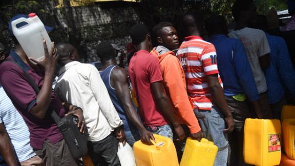People wait in line for gas in the Port-au-Prince commune of Petion-Ville on Sunday, February 17.