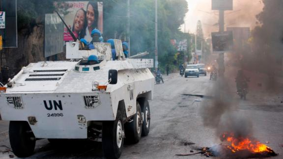UN forces from Senegal patrol a street in Port-au-Prince on Saturday, February 9.