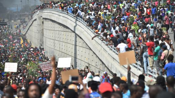Demonstrators march through the streets of Port-au-Prince, Haiti, on Thursday, February 7, demanding the resignation of Haitian President Jovenel Moise.