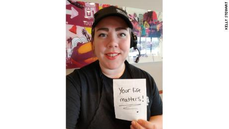 27-year-old Kelly Stewart hands out inspirational notes to her customers at this Syracuse, New York, Taco Bell.